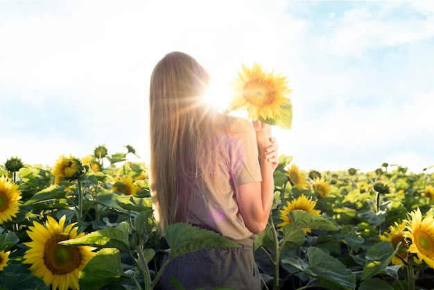 Beautiful woman with sunflower