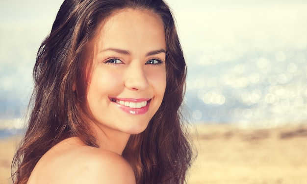 Beautiful woman with sunscreen solar cream over