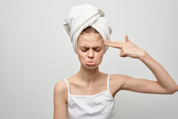 Beautiful woman with a towel on my head cosmetology studio