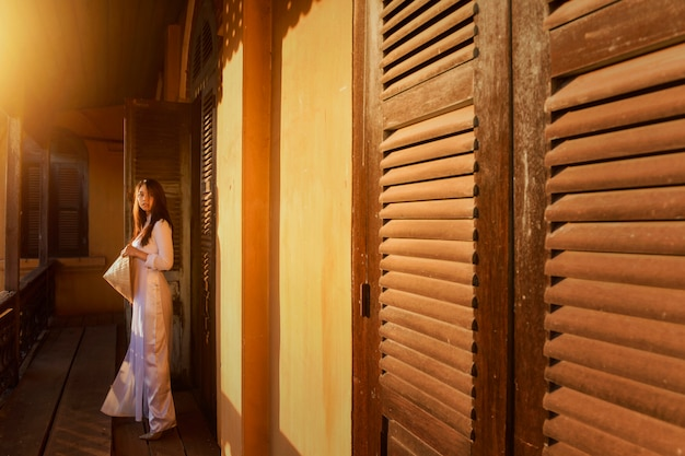 Beautiful woman with vietnam culture traditional, vintage style, hoi an vietnam