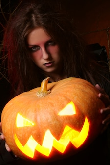 Beautiful woman witha pumpkin in the hands
