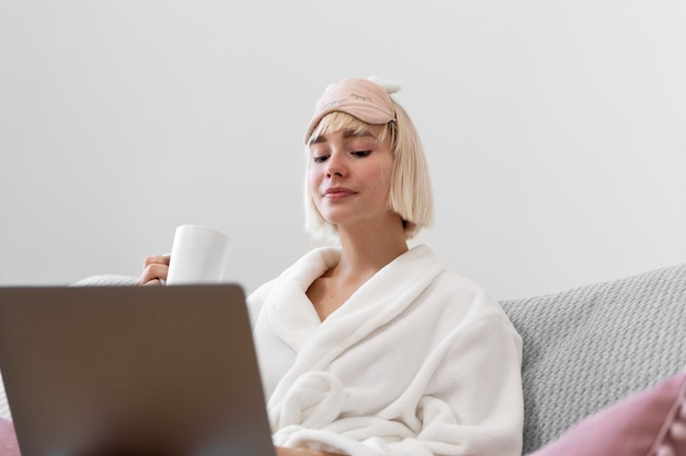 Beautiful woman working after waking up of her sleep