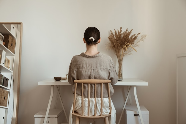 Beautiful woman working at home. cozy comfortable home office workspace interior design