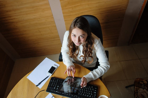 Beautiful woman working in the office at the computer