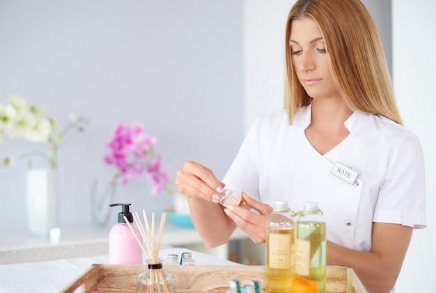 Beautiful woman working at spa salon