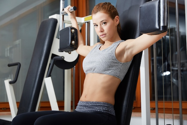 Beautiful woman workout in gym