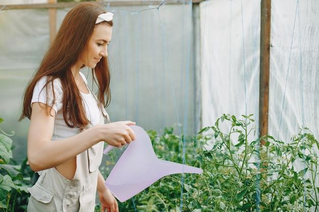 Beautiful woman works in a garden