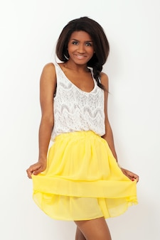 Beautiful woman in a yellow skirt