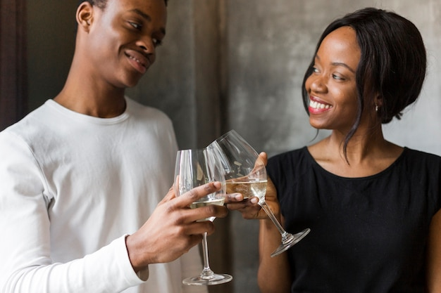 Beautiful woman and young woman toasting wine