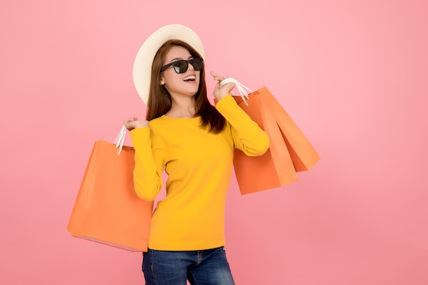 Beautiful women are shopping in the summer with blue paper bags