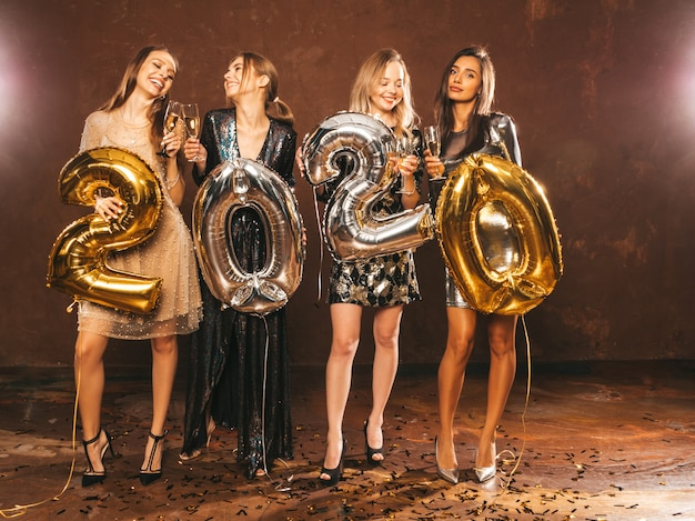 Beautiful women celebrating new year.happy gorgeous girls in stylish sexy party dresses