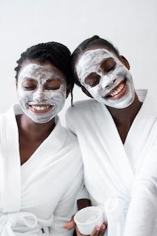 Beautiful women doing a facial treatment at home