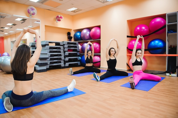 Beautiful women doing fitness or pilates exercise and stretching