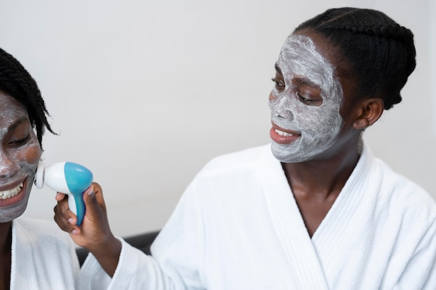 Beautiful women doing a self care treatment at home