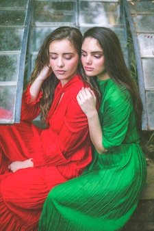 Beautiful women in dresses looking down