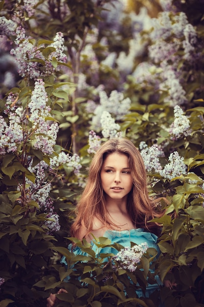 beautiful women enjoying lilac garden young women with flowers green park cheerful teenagers walking outdoor soft light style color 137237 550