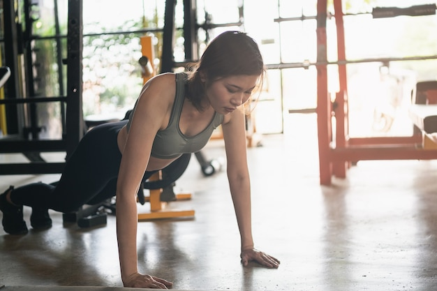 Beautiful women exercise push up in the gym, sport fitness concept