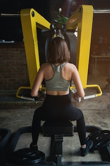 Beautiful women exercise training in the gym, sport fitness concept