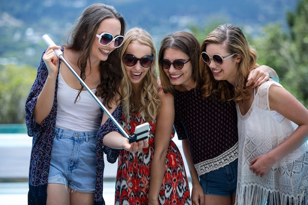 Beautiful women looking at mobile phone and smiling