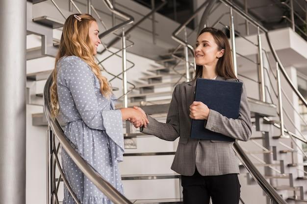 Beautiful women shaking hands