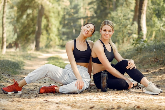 Beautiful women spend time in a summer park