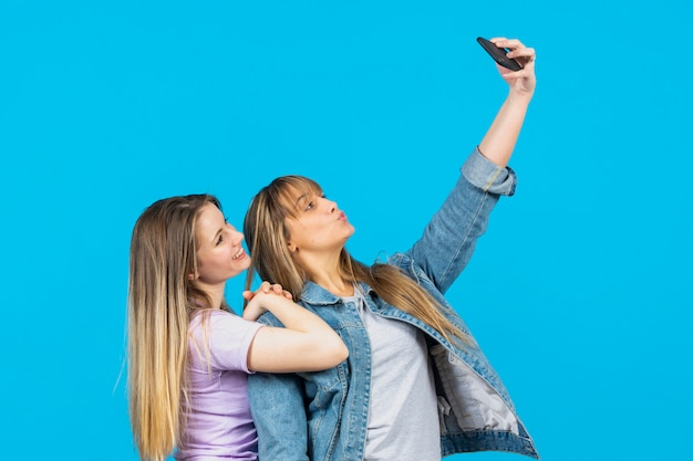 Beautiful women taking selfies together