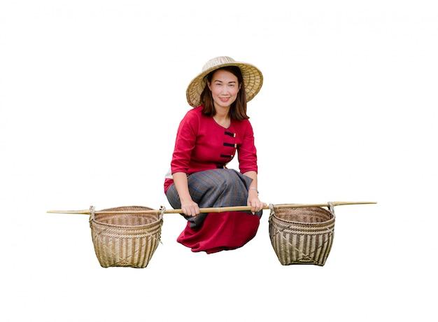 Beautiful women in thai dress carry basket on shoulder
