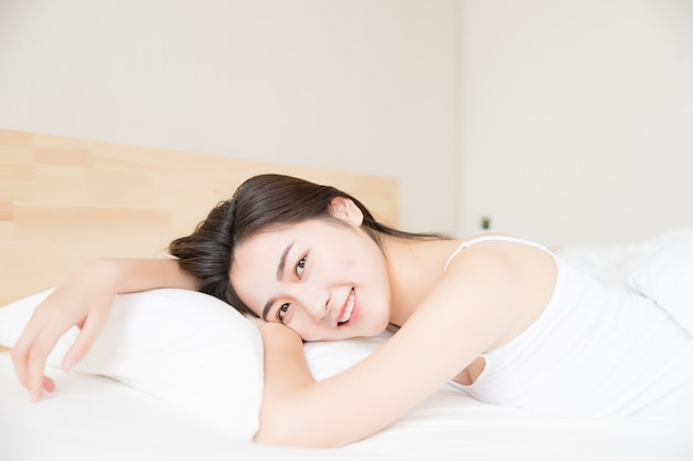 Beautiful women wake up in bed in the morning.