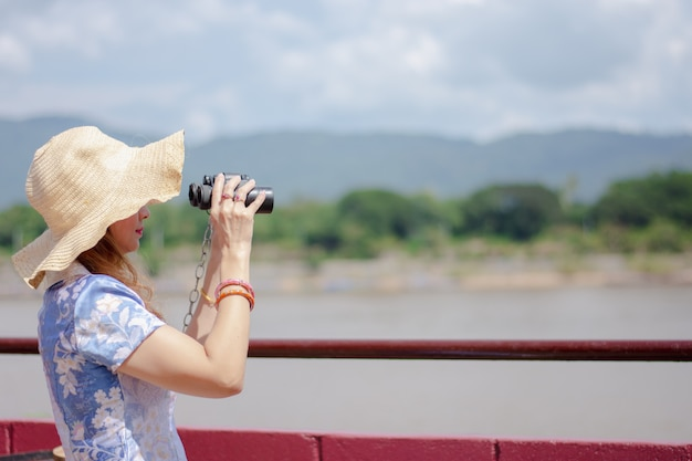 Beautiful women watch the mekong river between thailand and the lao pdr.