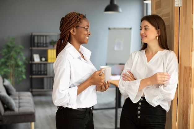 Beautiful women working together in a startup company