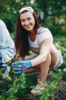 Beautiful women works in a garden