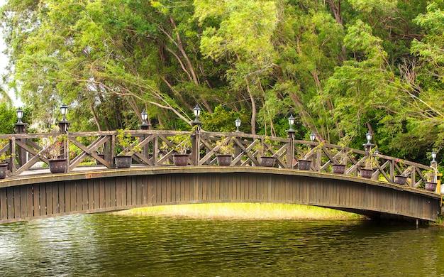 Beautiful wooden bridge across river.