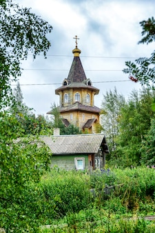Beautiful wooden church in the landscape. vertical.