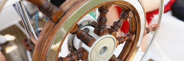 Beautiful wooden vintage steering wheel on a yacht navigation device for sea transport
