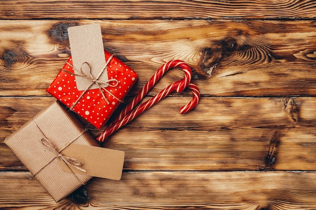 Beautiful wrapped christmas gifts on wooden background top view