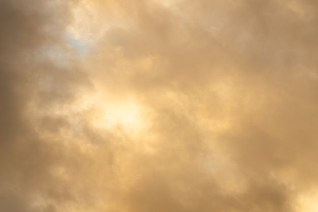 Beautiful yellow sky with clouds at sunset. background for designer