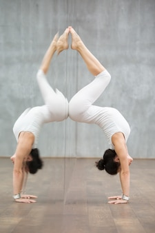 Beautiful yoga: handstand pose with backbend