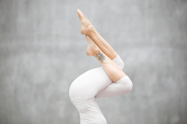 Beautiful yoga: headstand, legs close up