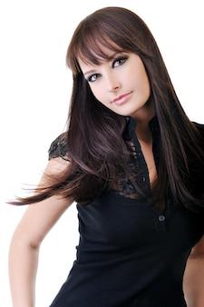 Beautiful young adult girl in black elegant dress posing