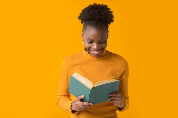 Beautiful young african woman with a book