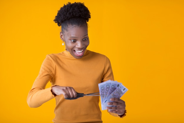 Beautiful young african woman with euro in hands