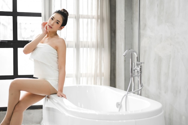Beautiful young asia woman enjoy relaxing taking a bath with bubble foam in bathtub at the bathroom
