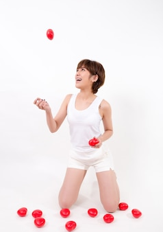 Beautiful young asia woman with red hearts. isolated on white background.