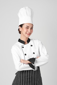 Beautiful young asian woman chef on white background, Premium Photo