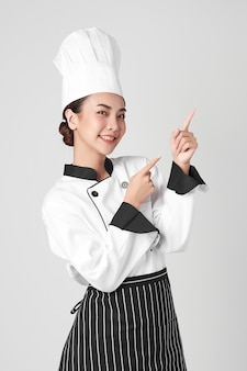 Beautiful young asian woman chef on white background,