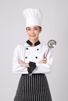 Beautiful young asian woman chef.