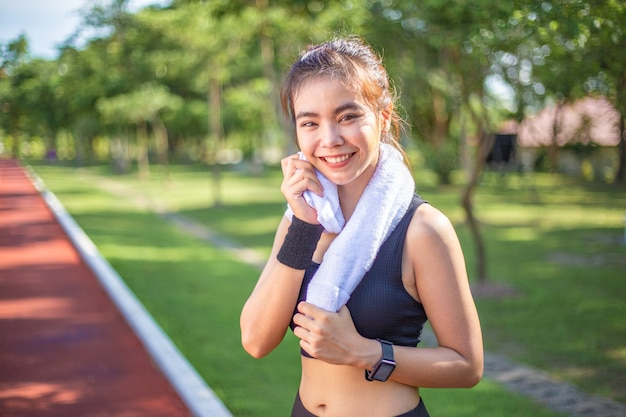 Beautiful young asian woman exercising in the morning at a running track