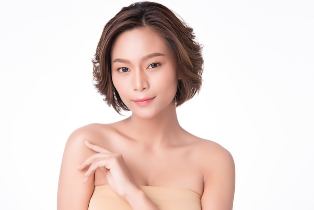 Beautiful young asian woman hand touching on shoulder. clean and fresh skin, beauty cosmetology concept,