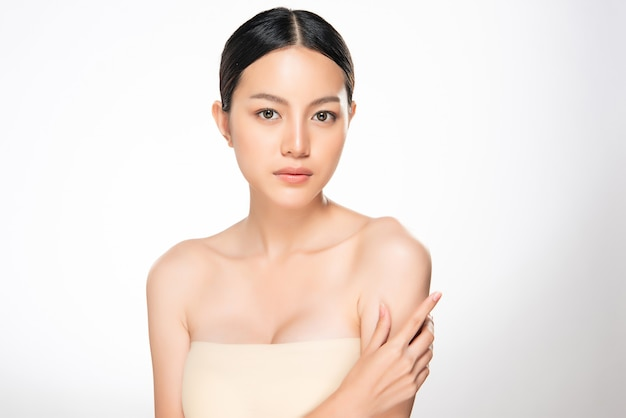 Beautiful young asian woman hand touching on shoulder. clean and fresh skin, isolated, beauty cosmetology concept,