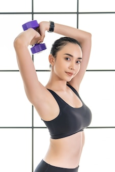 Beautiful young asian woman in is exercise class